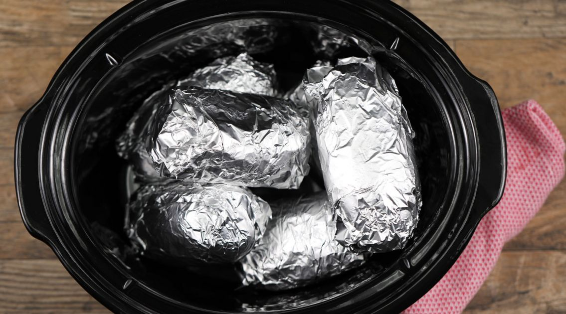 Wrap potatoes in tin foil and put in crock pot. Enjoy this lip-smacking result